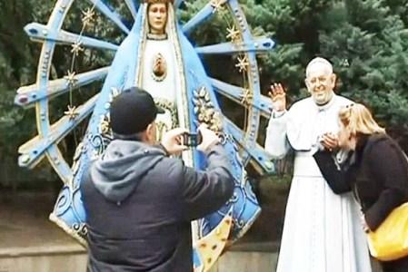 Roman Catholics caught in a moment of idolatry.