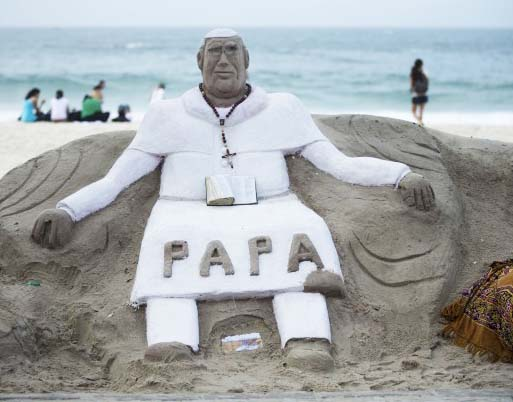 """The """"Pope"""" rests in the sand on CopaCabana beach in Rio."""