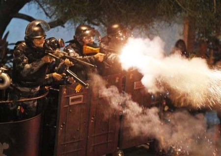 Some of the riot police used tear gas against the protestors.