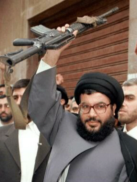 "Hasan Nasrallah with a gun. The EU must find out if he is connected to the ""military wing""."