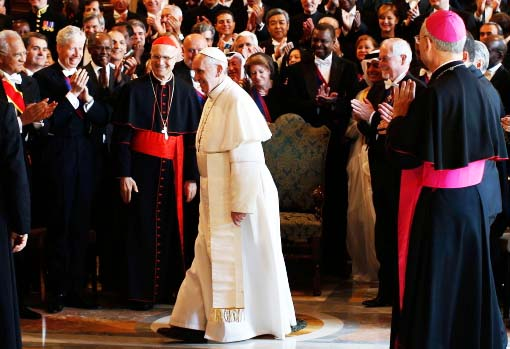 "Ambassadors from all nations greets the Pope as their ""Holy father""."