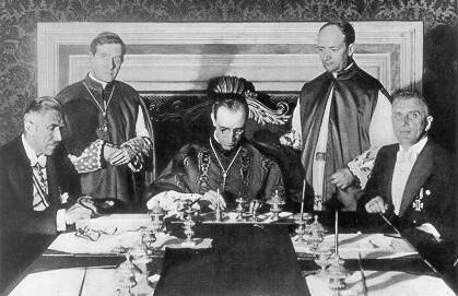 "Eugenio Pacelli, later Pope Pius XII, signs the ""Reichskonkordat"" with the national socialist government under Adolf Hitler on July 20, 1933"