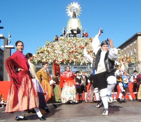 Spaniards dancing in front of the prostitute during her religious festival.