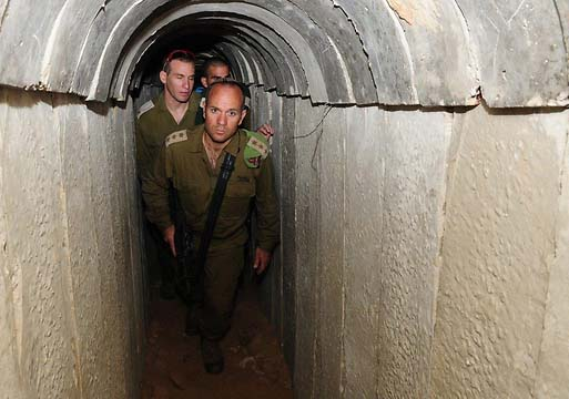 Israeli officers walk in the discovered tunnel of terror.