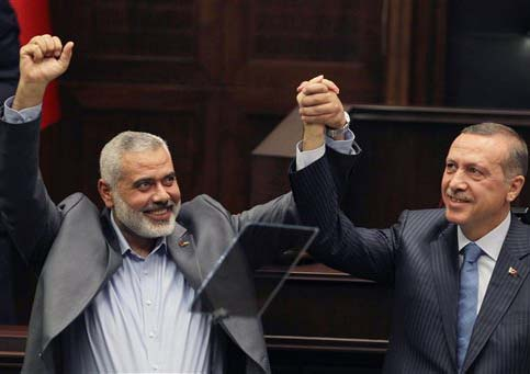 Turkish PM Erdogan celebrate anti-Zionist victories with Hamas leader Ismail Hanyeth.