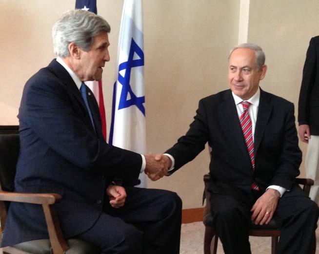 Benjamin Netanyahu greets John Kerry, as both men continue to play political games.