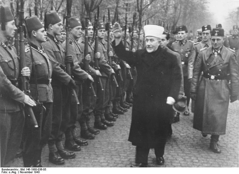 The Grand Mufti of Jeruslaem incpect a Nazi Waffen SS brigade in Croatia in 1942.