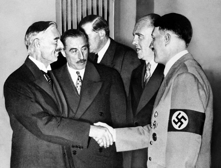 Chamberlain seals the deal with Herr Hitler.