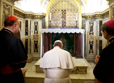 Pope Francis, flanked by Cardinal Angelo Comastri, left, and Bishop Vittorio Lanzani, right, kneels in prayer in front of what is believed to be the burial site of St. Peter's Read more: http://www.ctvnews.ca/world/pope-francis-takes-emotional-up-close-visit-to-tomb-of-st-peter-1.1218700#ixzz2kMr4af65