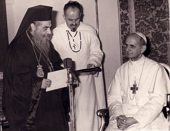 Pope Paul VI and Patriarch Athenagoras at Jerusalem in January 1964.‬
