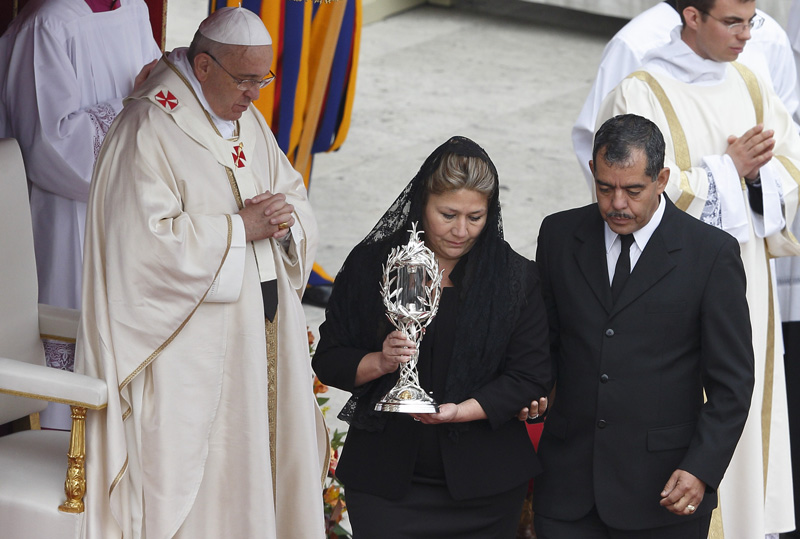 "Floribeth Mora Diaz carry the container with ""holy blood""."