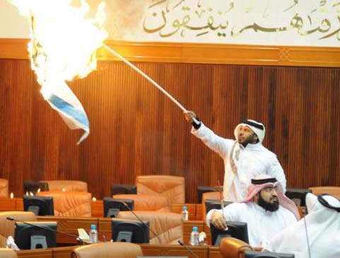 Nov. 20, 2012 MP's in Bahraini burns the Israeli flag.