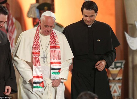The Pope is dressed up with the symbols of terrorism.