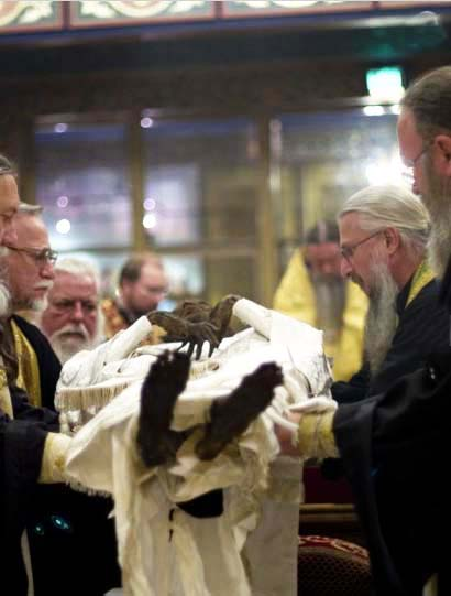 Orthodox clergy in America, in the prosess of dressing up a corpse
