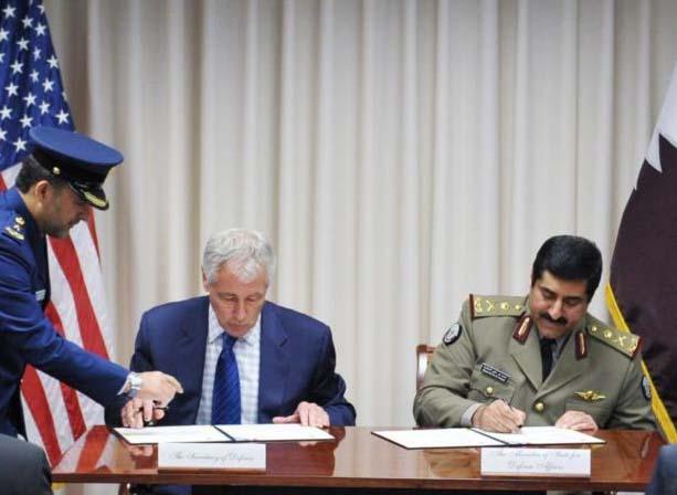 Chuck Hagel and Qatar's Defence Minister, Hamad bin Ali al-Attiyah.