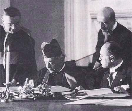 "Roman Catholic cardinal sign the ""peace deal"" with Facsist dictator Benito Mussolini."