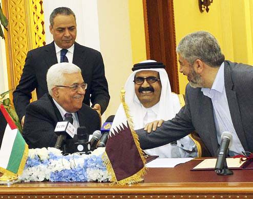 Khaled Meshaal shake hands as Qatar's Emir Sheikh Hamad bin Khalifa al-Thani and Mahmoud Abbas.