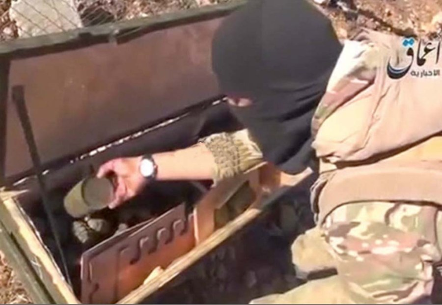 And ISIL terrorists looks through some weapons dropped inside Syria by US aircrafts.