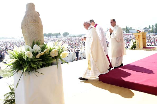 "The Pope gets ready to stand before the ""Queen of heaven""."