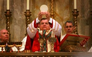 "Cardinal Burke worshiping the pagan sun ""god"" in the name of Christ."