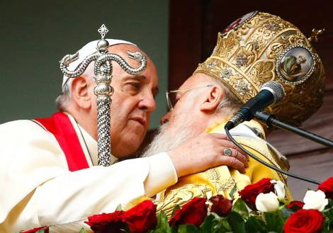 "Two religious leader embrace each other, promise to bring ""peace"" to the Earth."