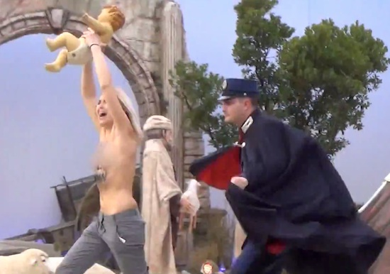 A half naked activists runs away with the Catholic copy of the Messiah.