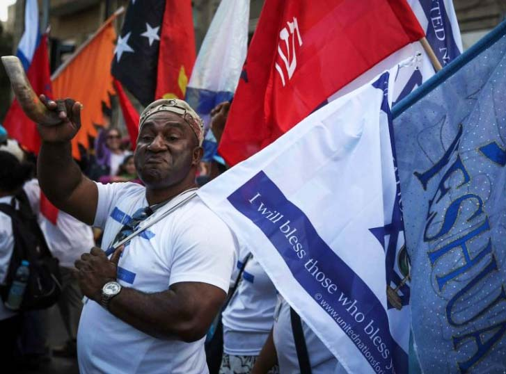 A believer in Yeshua walks in support of Israel during the Jerusalem march that us arranged every October.