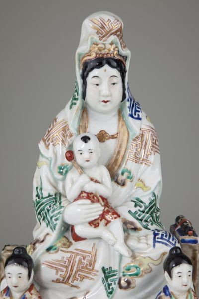 Maria-Kannon: The Virgin Mary portrayed in the form of the bodhisattva Kuan Yin who is known in Japan as Kannon‬. She is also the mother of Buddha.