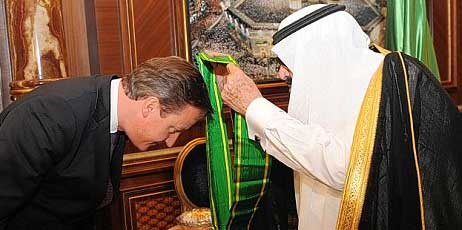 David Cameron bow befoe the islamic king of Saudi Arabia.
