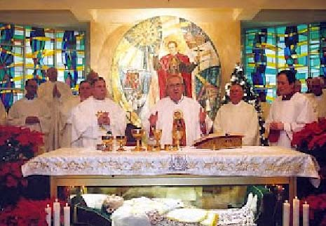Catholic priests in the US conduct a mass with a corpse resting inside the altar.