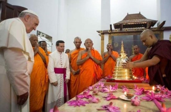 The Pope bow before the relicts of the claimed saints of Buddha.