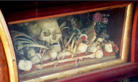 The skull is normally kept for disply in a box under the altar.