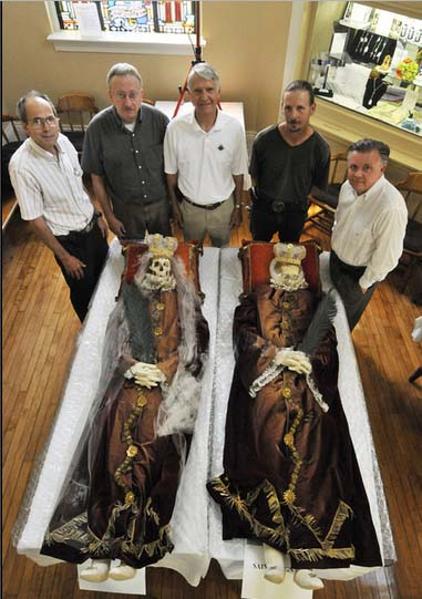 Some Catholic Order brothers wants to take a selfie with the two corpses.