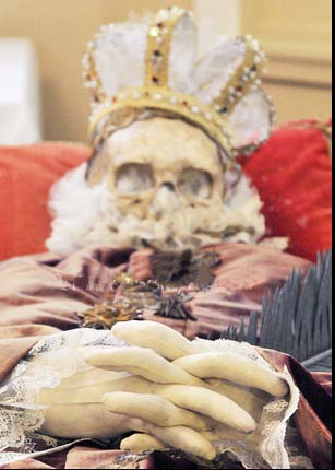 A skull is set on top of the puzzled skeleton, and fingers are made from plastic foam.