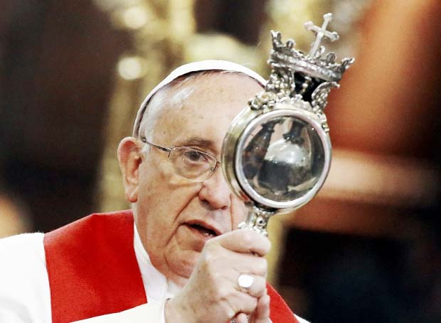 "The ""holy blood"" is kept in a Eucharistic kind of golden container."