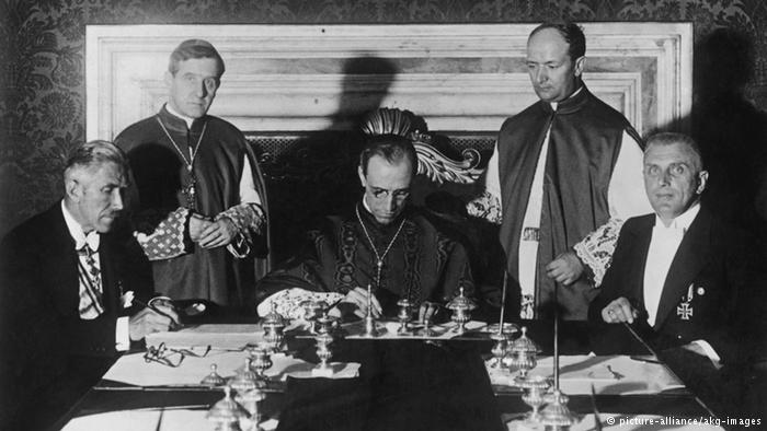 Hitler's Pope Pius XII signs the deal that securered the Vaticans right inside Nazi-Germany.