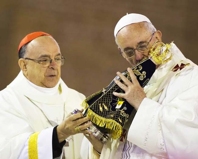 The Pope kisses the