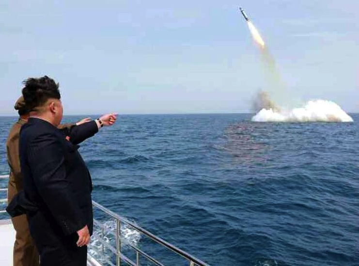 Kim Jong Un watch North Korea's first balistic missile fired from a submarine.