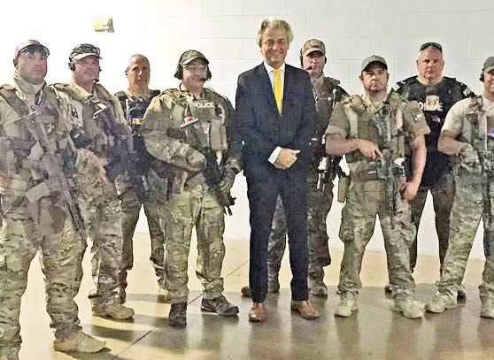 Geert Wilders protected by armed security guards. He was the target of Jihadists in Dallas.