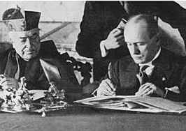 Cardinal Gasparri signs the deal with Benito Mussolini.