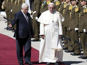 Pope Francis and Palestinian President Mahmoud Abbas (L) review troops as they arrive at the presidential palace for a welcoming ceremony on May 25, 2014 in the West Bank Biblical town of Bethlehem. Pope Francis arrived in Bethlehem to begin the most sensitive part of his three-day Middle East tour aimed at forging regional peace and easing an age-old rift within Christianity. AFP PHOTO / AHMAD GHARABLI