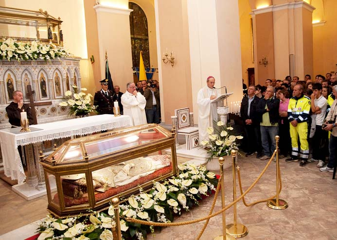 A mass is conducted to honor the exhumed corpse.