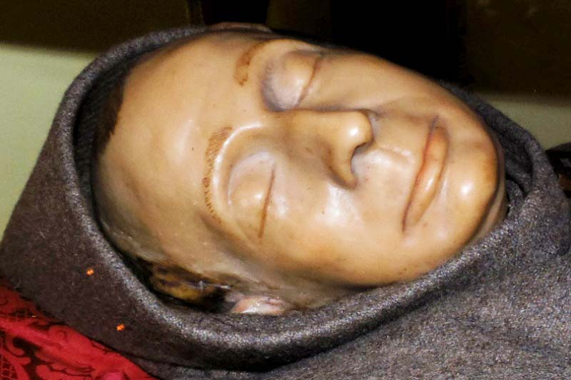 Behind this death mask, there is most likely an exhumed skull.