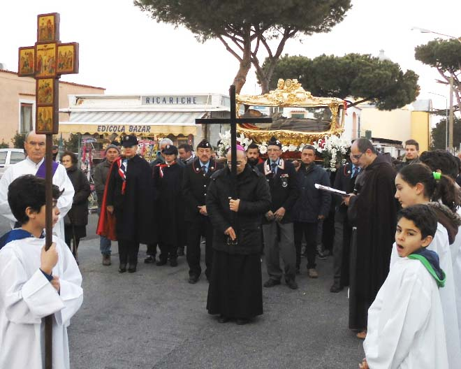 The flesh of a mortal man is paraded behind a cross in a town in central Italy.