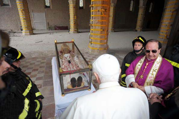 Pope Benedict came to pray to the skull and bones of a a Pope who has been dead for 700 years.
