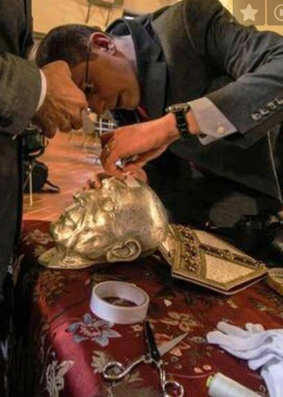 A new death mask is placed over the skull.
