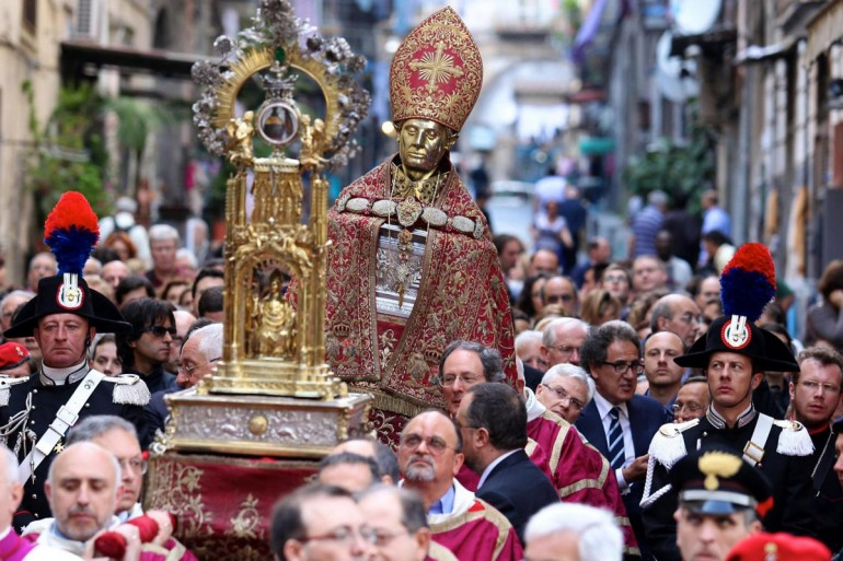The head of Januarius and the container with his claimed blood of paraded through the street of Naples.