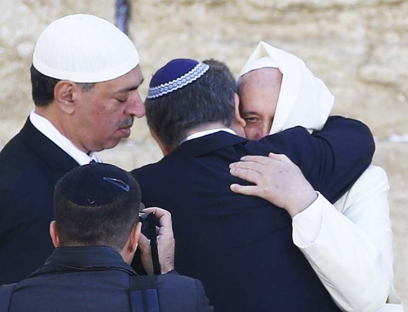 The Pope is kissed and greeted by a Jewish Rabbi at the Holiest site of Judaism.