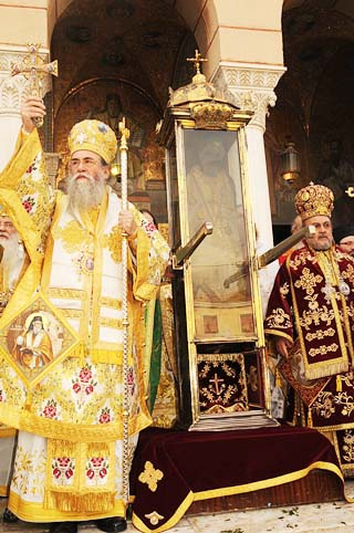 The Orthodox priests carry their
