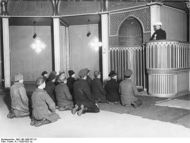The sons of Muhammad are hailed in a mosque in Berlin, during the time of rise of Nazism in Germany.